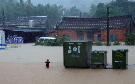 Taiwan battles floods as torrential rain hits